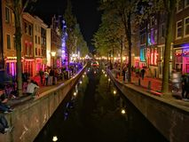 Red lights canal street night royalty free stock photography
