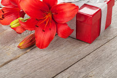 Red lily flower and gift box Royalty Free Stock Photo