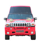 Red limousine with wedding decorations Royalty Free Stock Images