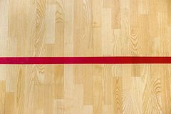 Red line on the gymnasium floor for assign sports court. Badminton, Futsal, Volleyball and Basketball court.  royalty free stock photo