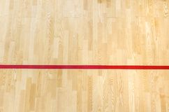 Red line on the gymnasium floor for assign sports court. Badminton, Futsal, Volleyball and Basketball court.  royalty free stock photos