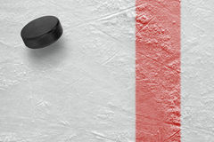 The red line and the puck hockey Stock Images