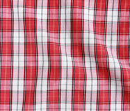 Red linen crumpled tablecloth. Stock Photos