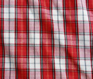 Red linen crumpled tablecloth. Stock Photo