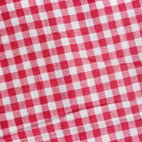 Red linen crumpled tablecloth. Royalty Free Stock Image