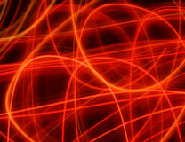 Red lines. Of light with black background Royalty Free Stock Photography