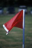 Red linesman flag. Used at soccer games Stock Image