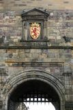 Red lion on golden emblem above the gate of Edinburgh castle Royalty Free Stock Photo