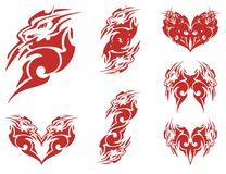 Red lion head and double symbols from it. Tribal flaming stylized lion head, red hearts and the ornate symbols formed from it on a white background Royalty Free Stock Image