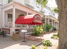 Red Lion Inn entrance red canopy. Red Loin Inn entrance red canopy, tree trunk Main Street , Stockbridge Massachusetts in summer, Berkshires royalty free stock images