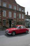 The red lion in lacock village with old Jaguar Car Royalty Free Stock Images