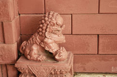 Red lion sculpture. With red brick wall Stock Image