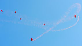 Red Lions parachuting during NDP 2012 Royalty Free Stock Images