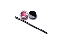 Red lip gloss in jar with makeup brush Royalty Free Stock Photos