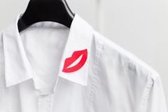 Red lip symbol on white men's shirt Stock Photography