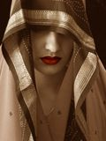 Red liped woman. Woman with red lips and shawl royalty free stock images