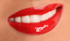 Red lips. And shiny white teeth Stock Photos