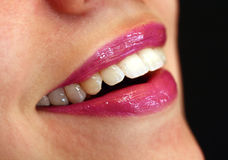 Red lips. Of a young woman, close up, laughing stock photo