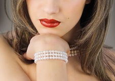 Red lips. Woman with red lips and perls Royalty Free Stock Photo