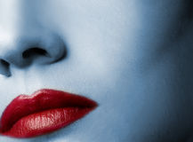 Red lips. And skin toned in blue Stock Images