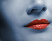 Red lips. And skin toned in blue Stock Photos
