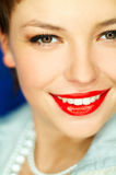 Red Lips. Portrait of beautiful young smiling woman with red lipstick Royalty Free Stock Images