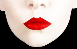 Red lips. Woman?s face with over emphasised red lips Royalty Free Stock Image