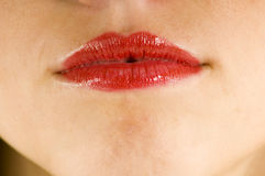 Red lips. Close up of lips with bright red lipstick Royalty Free Stock Photo