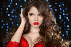 Red lips. Attractive girl portrait. Wavy hair. Beautiful fashion Royalty Free Stock Photo