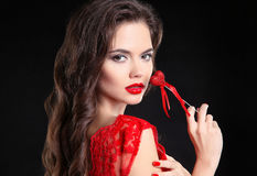Red lips. Beautiful brunette girl portrait holding heart gift fo Royalty Free Stock Images