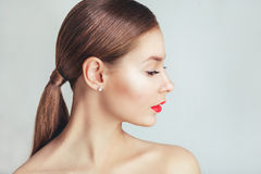 Red Lips. Beautiful model girl with red lips Stock Photo