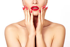 Red lips and bright manicured nails. Sexy open mouth. Beautiful manicure and makeup. Celebrate make up and clean skin Royalty Free Stock Images