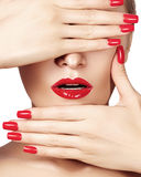 Red lips and bright manicured nails. Sexy open mouth. Beautiful manicure and makeup. Celebrate make up and clean skin Royalty Free Stock Image