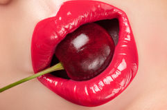 Red lips with a cherry. Royalty Free Stock Photos