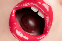 Red lips with a cherry. Royalty Free Stock Image