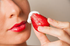 Red lips and delicious strawberry Stock Photography