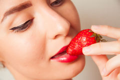 Red lips and delicious strawberry Stock Images