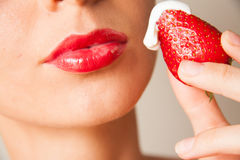 Red lips and delicious strawberry Royalty Free Stock Image