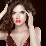 Red lips. Fashion beauty brunette woman model with wavy hair and Royalty Free Stock Images