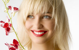 Red lips and flower Royalty Free Stock Photography