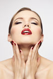 Red lips girl with closed eyes. Joy concept Stock Photography