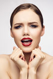 Red lips girl screaming to camera Stock Photography