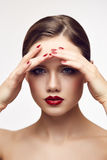 Red lips girl touching forehead Stock Photography