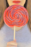 Red lips and lollipop. Girl with red lips and lollipop Royalty Free Stock Photos