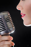 Red lips and microphone Royalty Free Stock Image
