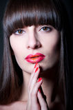 Red lips and nails Stock Photography