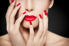 Red Lips And Nails Royalty Free Stock Images