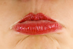 Red lips pouting. Female lips pouting with bottom lip out wearing bright red lipstick Stock Photography