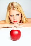 Red lips and a red apple Stock Photo