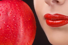 Red lips and red apple. Royalty Free Stock Images